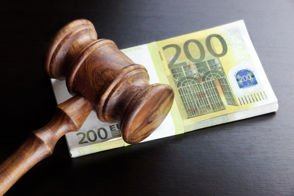 Concept For Corruption Bankruptcy Bail Crime Bribing Fraud Auction Bidding. Judges or Auctioneer Gavel Soundboard And Euro Cash On The Rough Black Wooden Textured Table Background.