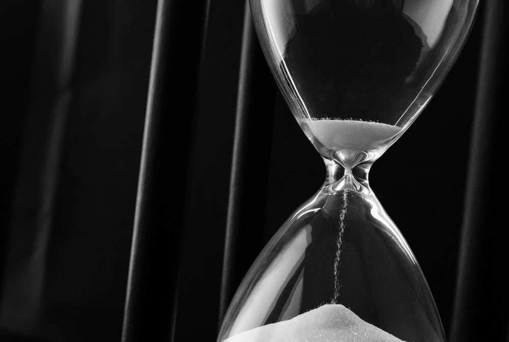 Sand Running Through The Bulbs Of An Hourglass