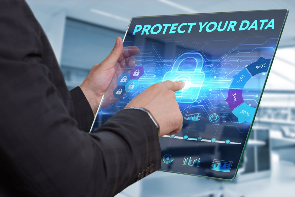 Business Technology Internet and network concept. Business man working on the tablet of the future select on the virtual display: Protect your data
