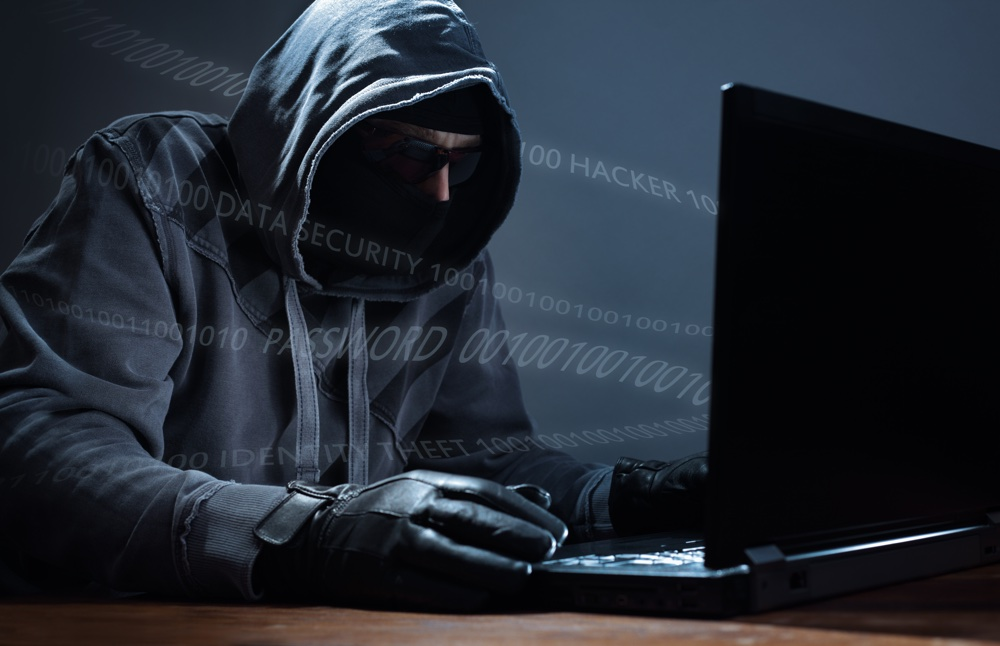 Computer hacker stealing data from a laptop concept for network security, identity theft and compute