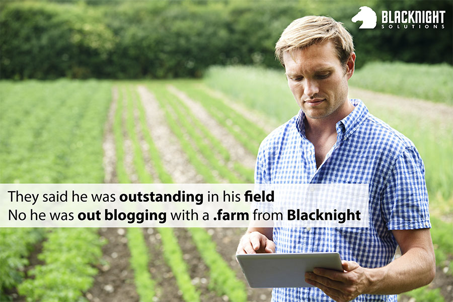 "Photo of man holding an iPad standing in a field with slogan ""they said he was outstanding in his field. No he was out blogging with .farm from Blacknight"""
