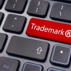 message on keyboard enter key to illustrate the concepts of trademark.