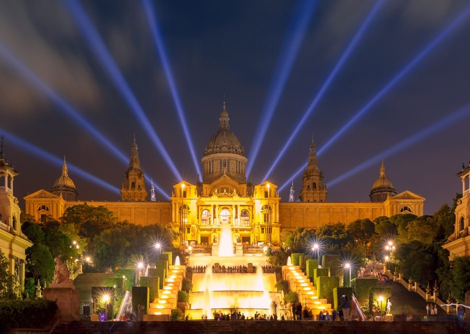 Famous light show and magic fountains in front of the National Art Museum at Placa Espanya in Barcelona at night, Catalonia, Spain
