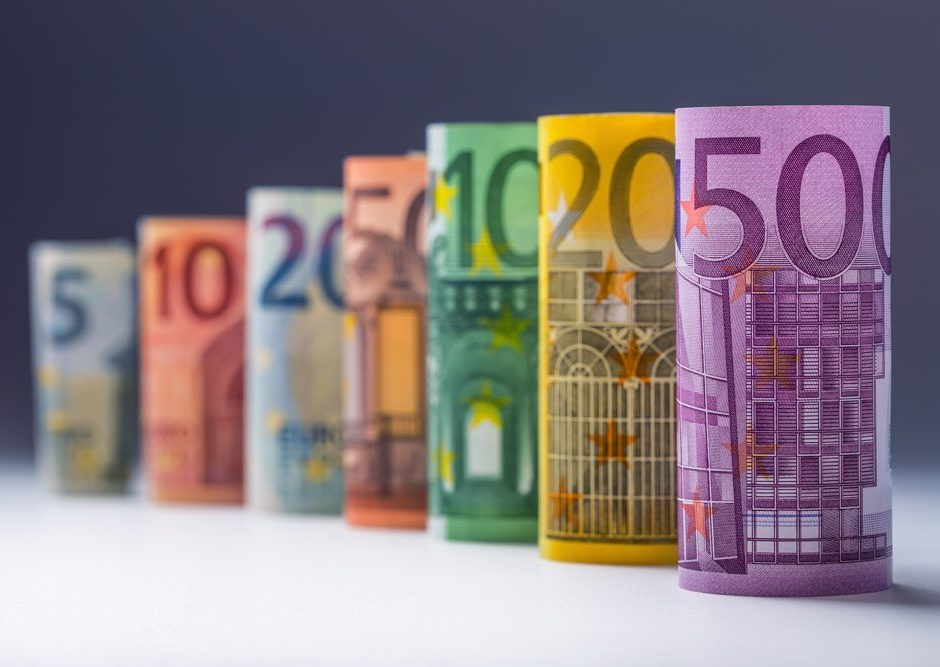 Several hundred euro banknotes stacked by value.Rolls Euro banknotes.Euro currency money.Announced cancellation of five hundred euro banknotes. Banknotes stacked on each other in different positions