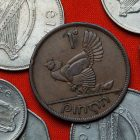Coins of Ireland. Hen with chickens depicted in the Irish one penny coin (1946).