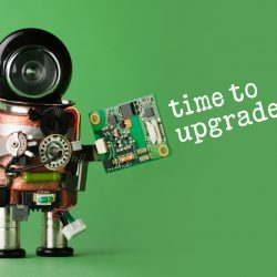 Time to upgrade concept. Robot with abstract circuit chip. retro style toy character with funny black helmet head. green background
