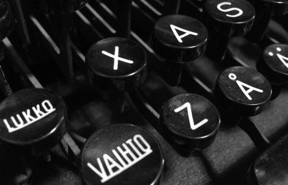 """Finnish vintage typewriter including uppercase """"Vaihto"""" (Shift), """"Lukko"""" (Caps Lock), letter A with ring, letter A with diaeresis, and ASDF keys."""