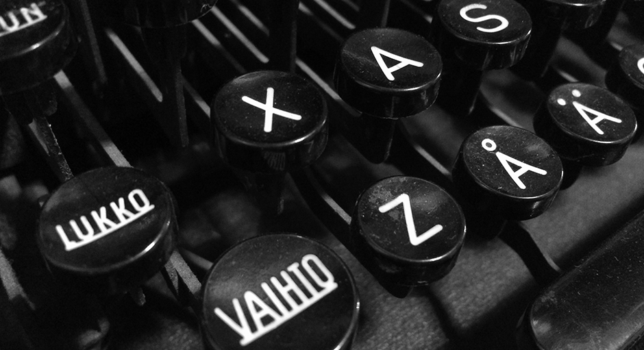 "Finnish vintage typewriter including uppercase ""Vaihto"" (Shift), ""Lukko"" (Caps Lock), letter A with ring, letter A with diaeresis, and ASDF keys."