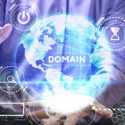 The concept of business technology the Internet and the network. A young entrepreneur working on a virtual screen of the future and sees the inscription: Domain