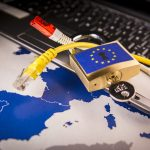 Padlock and net cable over a laptop and a EU map, symbolizing the EU General Data Protection Regulation