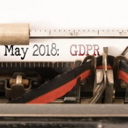 GDPR EU General Data Protection Regulation and commencement date written on vintage manual typewriter