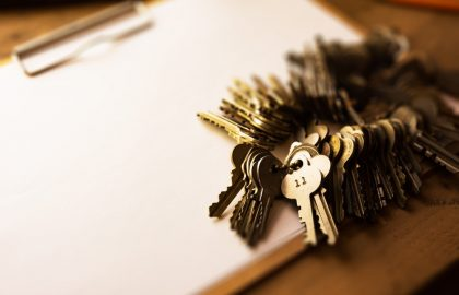 Many brass and chrome old keys on a clipboard with blank white paper. Security and encryption, concept image.