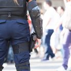 Female police officer on duty. State of emergency. Counter-terrorism.