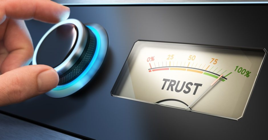 Hand turning a knob up to the maximum Concept image for illustration of trust in business.