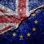 eu and union jack flag on grunged and cracked background