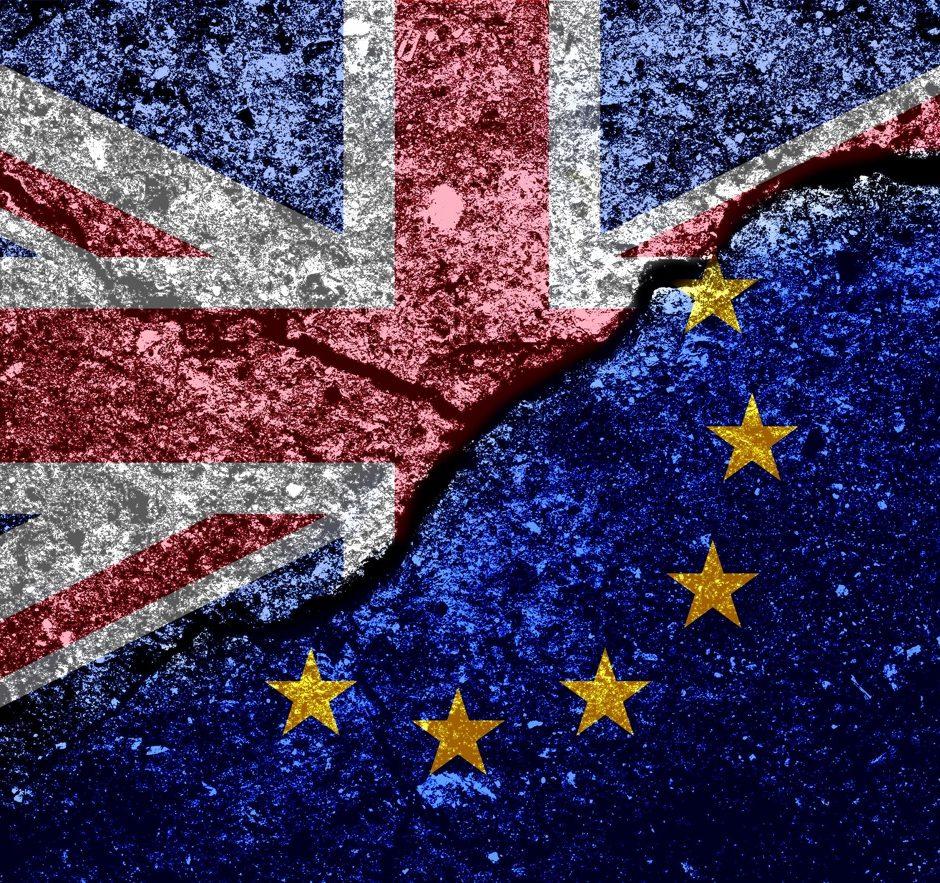 eu and union jack flag on grunged and cracked background