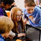 Kids coding using Scratch. Image courtesy of the Scratch Foundation