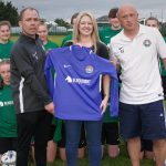 Leona Glover of Blacknight presents the new team jerseys to the Carlow U-15 Girls' Gaynor Cup Team