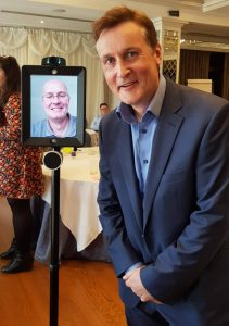 Sean Brady poses at the inaugural GrowRemote event, with a virtually present Eoin Kennedy, founder of Congregation. Photo: Cloud Assist