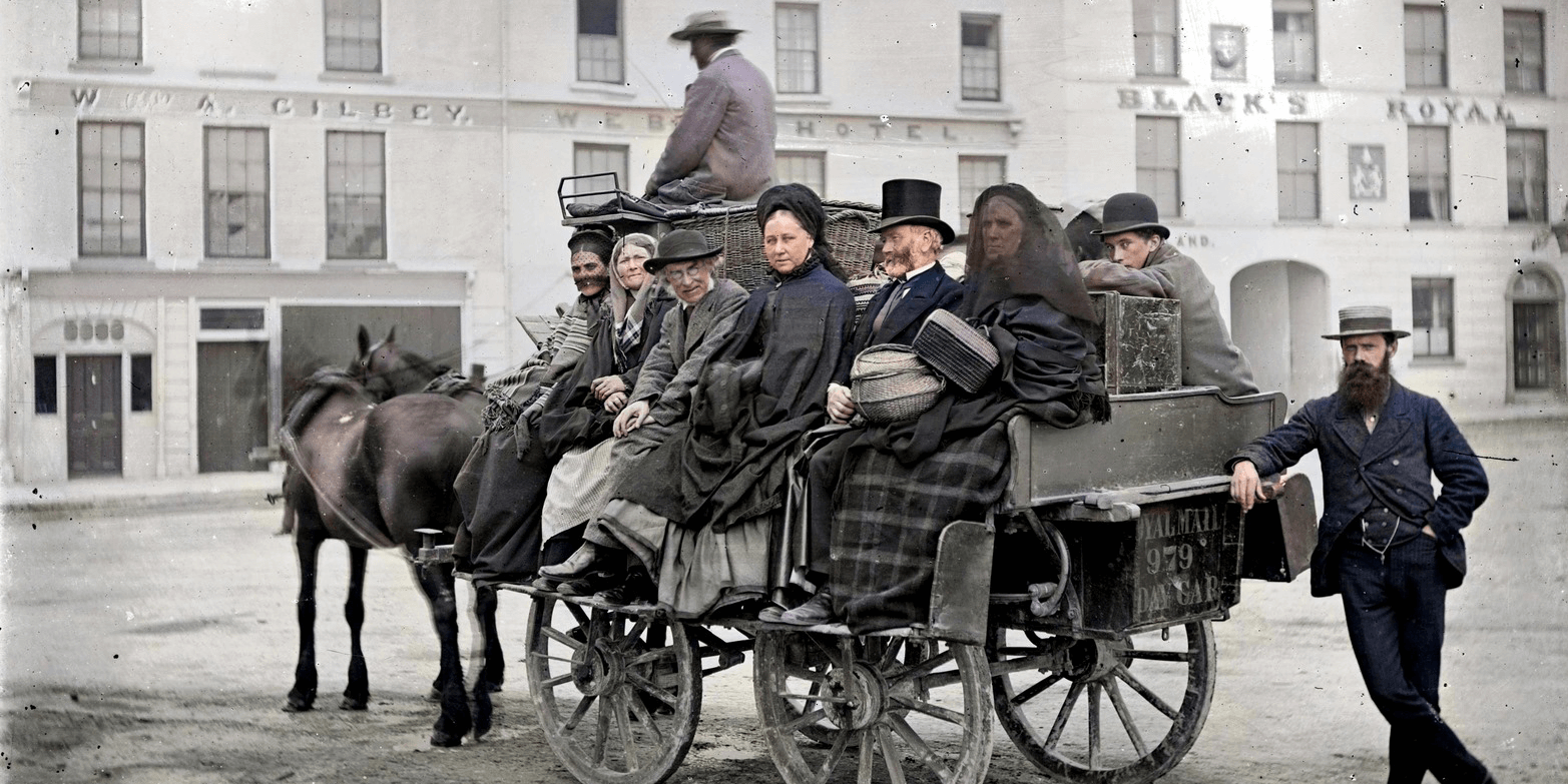 Royal Mail 979 Day Car This is a mail car near Black's Royal Hotel, Eyre Square in Galway city, loaded up with a fabulous mix of passengers. Eyre Square, Galway Date: Circa 1880? NLI Ref.: L_CAB_00895 Source: https://buff.ly/31bINIu @NLIreland #DeOldify @ColorizeImages #Photoshop