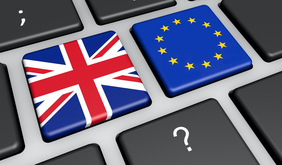 Brexit concept with UK and EU flag on a computer keyboard 3D illustration.