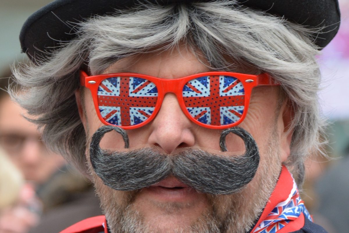 Man with union jack glasses, hat and more